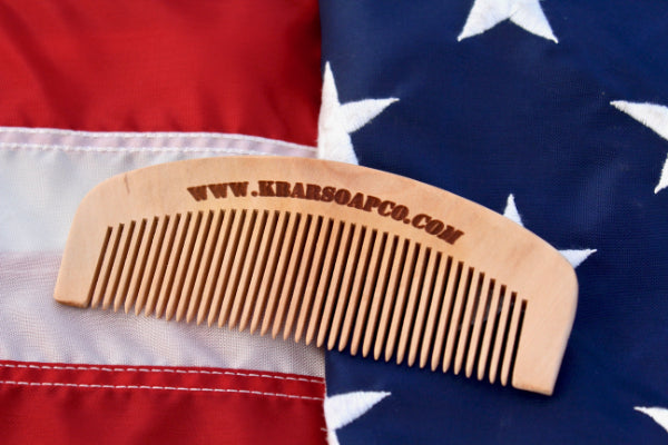 Wooden Comb by K Bar on an American flag