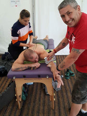 This is an image of Alfie Tatnell ACG Massage treating a customer UK