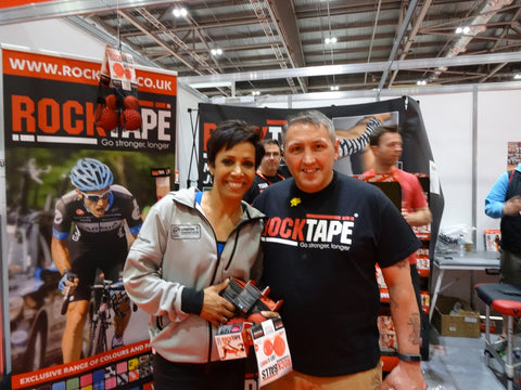 This is an image of Alfie from ACG Massage with Dame Kelly Holmes at The London Marathon UK