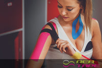 This is an image of a female weight lifter wearing REA Tape Kinesiology Tape Classic Pink K Tape 5cm x 5mtr UK Supplier