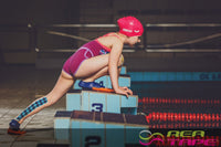 This is an image of a child swimmer wearing REA Tape Kinesiology Tape Argyle 5cm x 5mtr Pediatric Tape