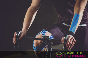 This is an image of a cyclist wearing REA Tape Kinesiology Tape Classic Blue K Tape 5cm x 5mtr UK Supplier