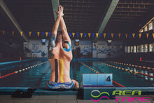 This is an image of a swimmer wearing REA Tape Kinesiology Tape Classic Blue K Tape 5cm x 5mtr UK Supplier