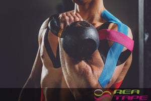 This is an image of a male kettle bell lifter wearing REA Tape Kinesiology Tape Classic Blue K Tape 5cm x 5mtr UK Supplier