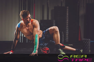 This is an image of a Male weight lifter wearing REA Tape Kinesiology Tape Classic Green K Tape 5cm x 5mtr UK Supplier