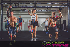 This is an image of a group of weight lifters wearing REA Tape Kinesiology Tape Classic Green K Tape 5cm x 5mtr UK Supplier