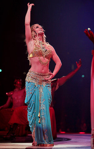 Britney Spears performing in Indian-inspired jewelry and outfit