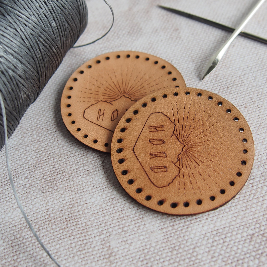 Leather patches with pre-cut holes engraved with the hord logo.