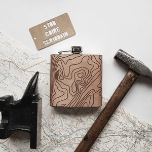 a personalised topographic hip flask, featuring the contour lines of Stob Coire Scriddain