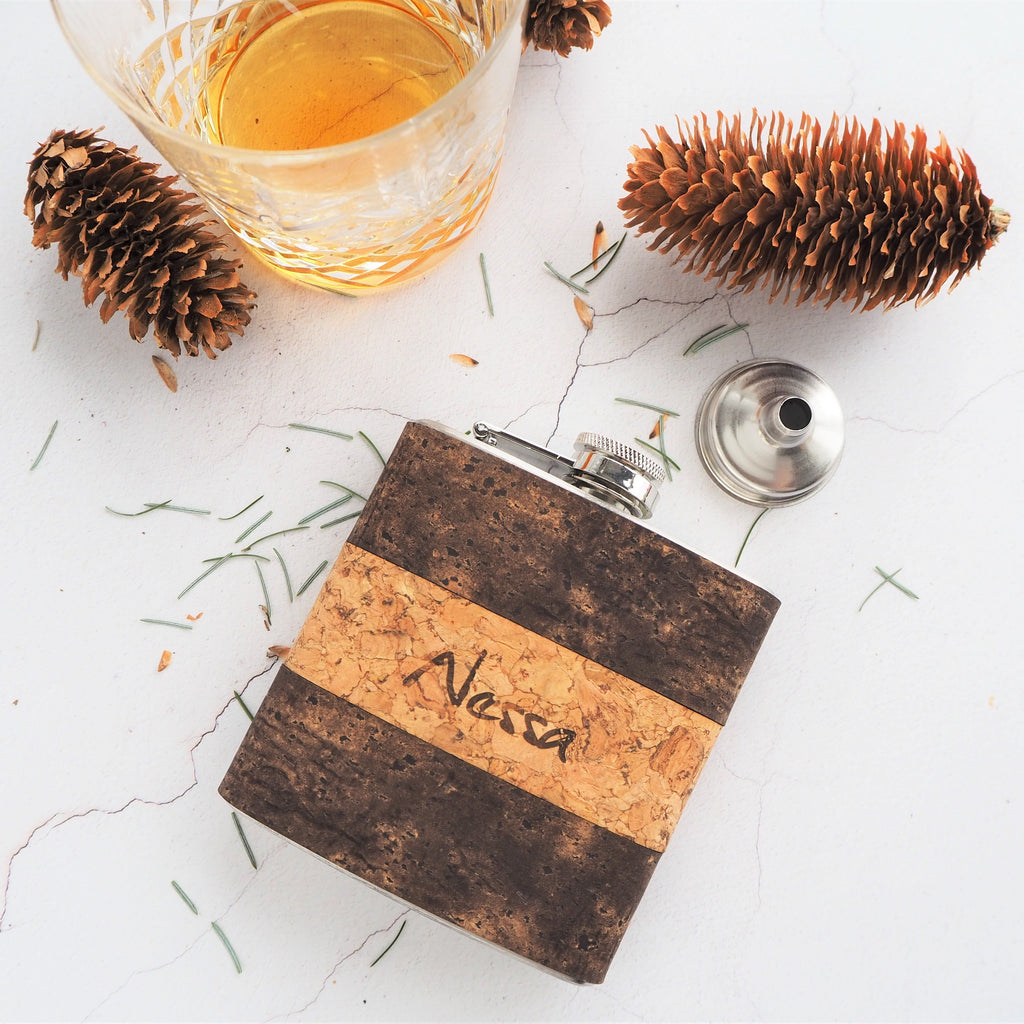 An engraved cork hip flask and dram of whiskey part of the vegan collection