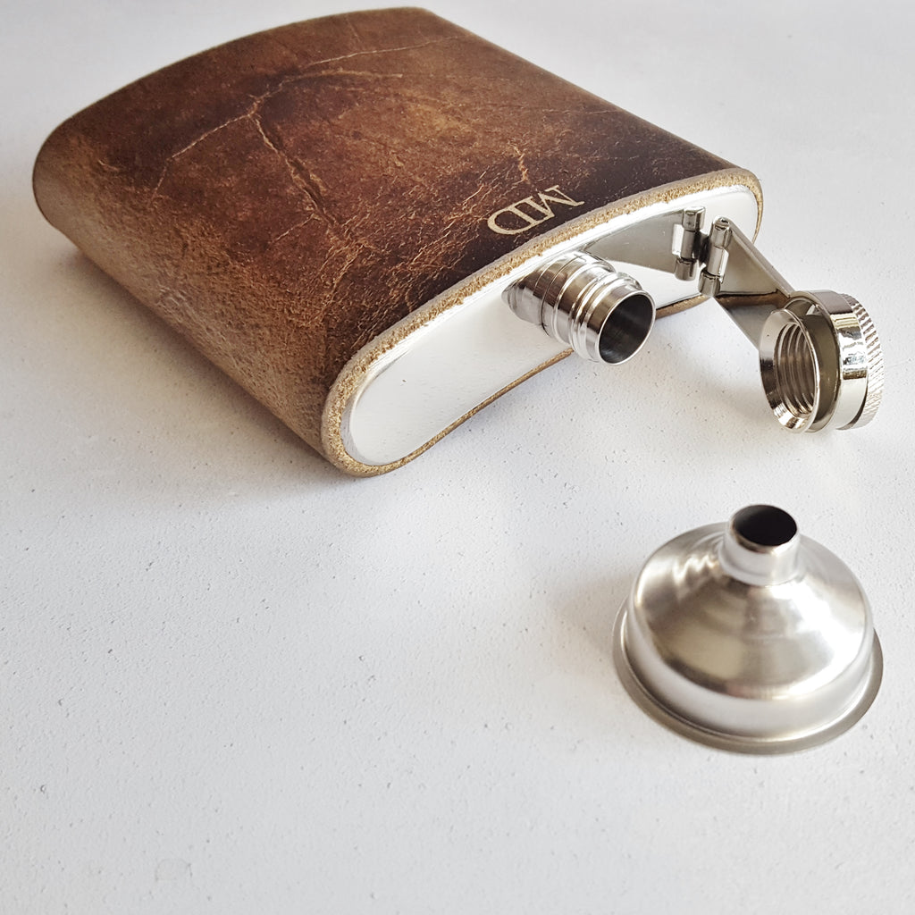 The Oak leather hip flask personalised with initials beneath the mouth piece.