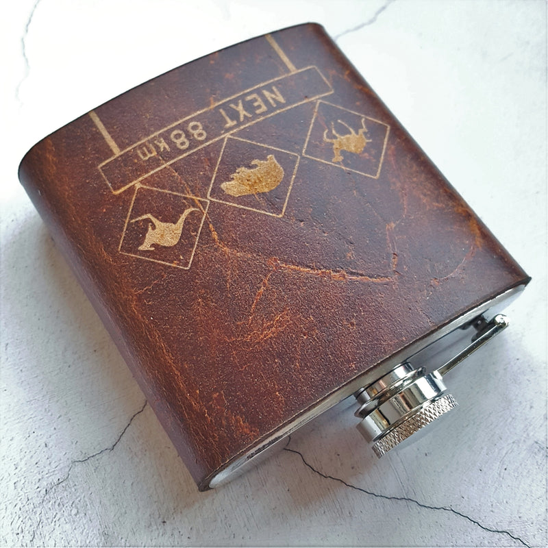 Custom engraved leather hip flask with Australian road sign design