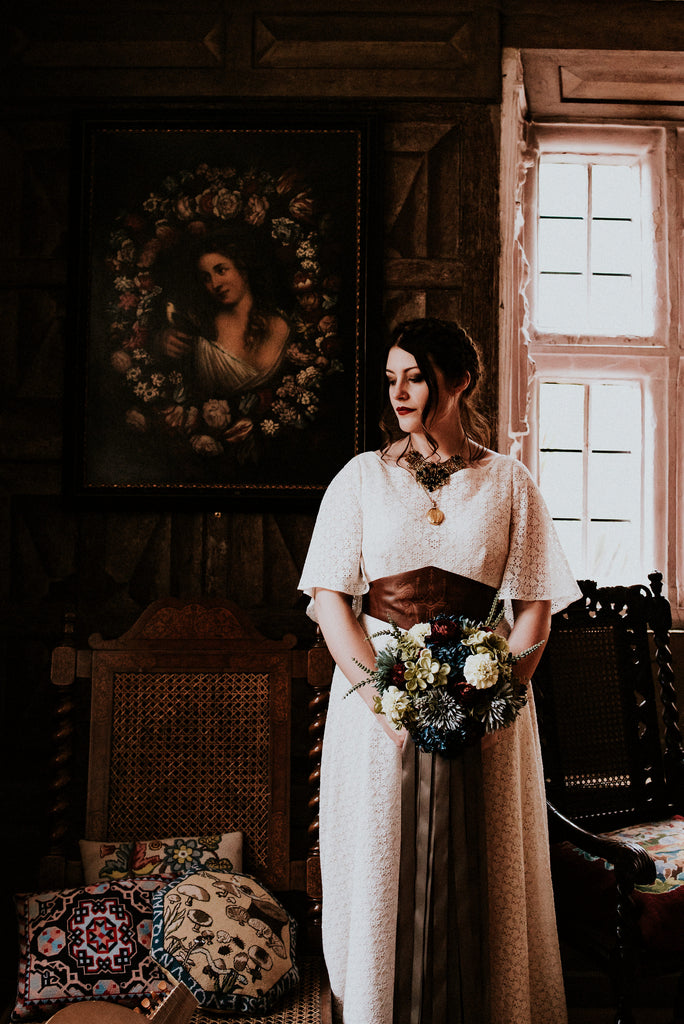 Medieval inspired lace wedding dress by Rolling in Roses. Belt by Hord, Photograph by Shutter Go Click.