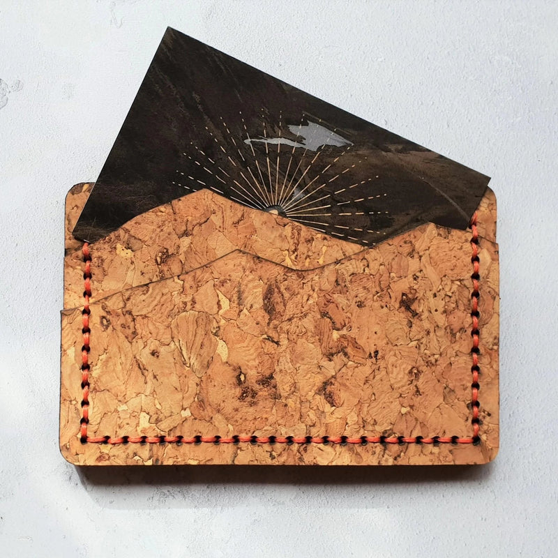 The cork mountain card holder in rugged and hard-wearing cork with orange hand-stitching. Several cards will fit in each slot, making this a great slimline solution for your pocket