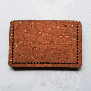 the back of the brown cork debit card holder with dark brown stitch. This incredibly tough and resilient cork is naturally waterproof
