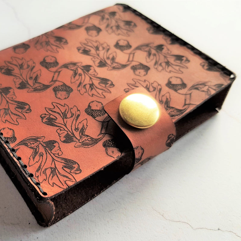 This Playing Card Case is engraved with a repeat pattern of acorns, perfect for keeping your deck of cards safe, by Hord