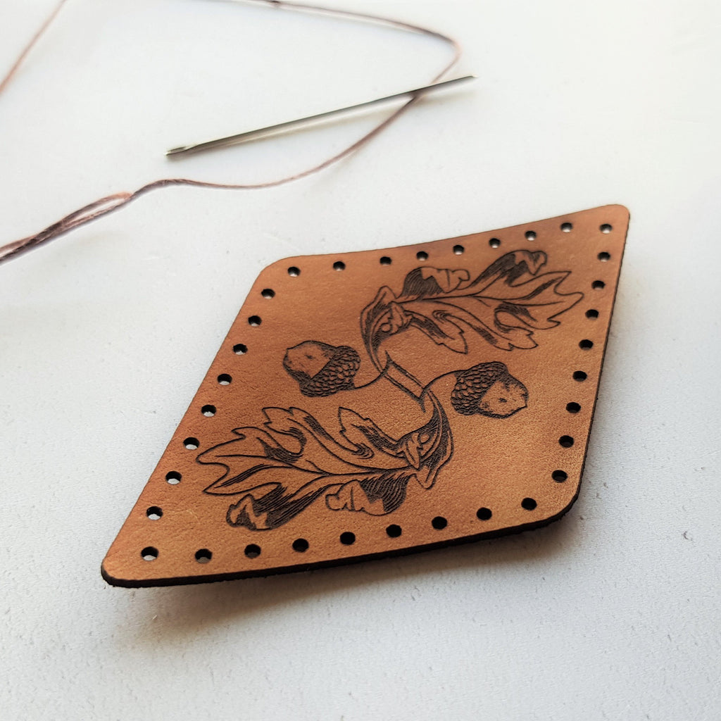 the texture of the flowing engraving on this acorn and oak leaf leather patch is beautiful to behold