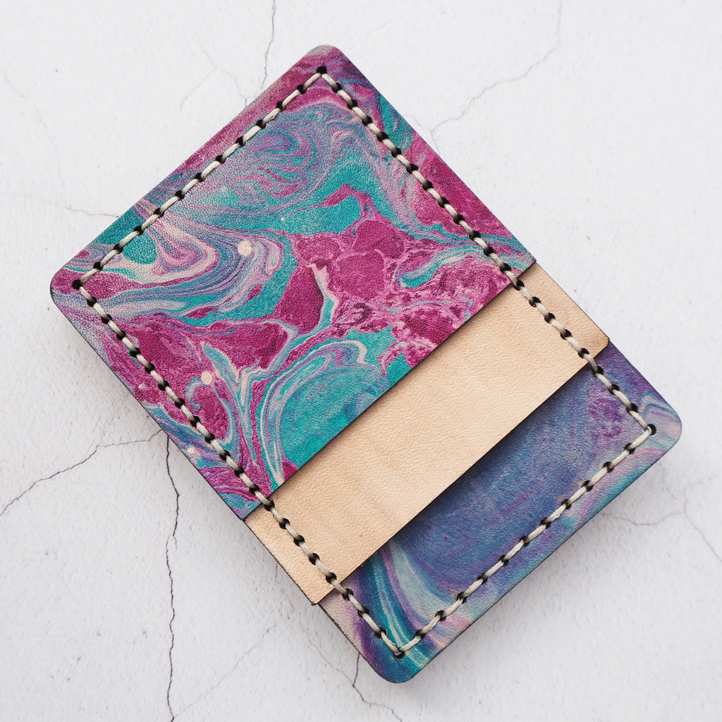 The Nebula Money Clip Card Holder, by Hord, marbled leather in purple and blue