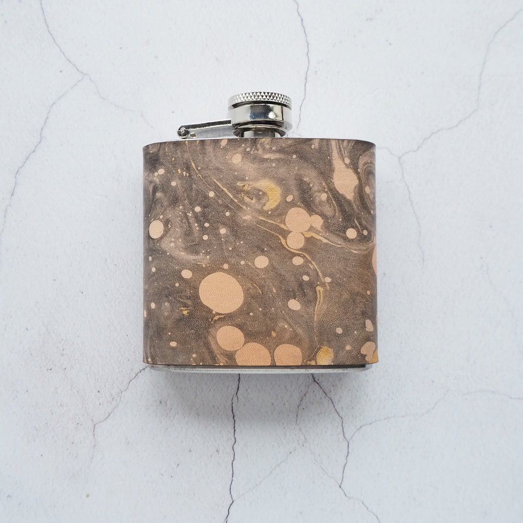 The Cosmos Hip Flask by Hord, Black and gold marbled hip flask