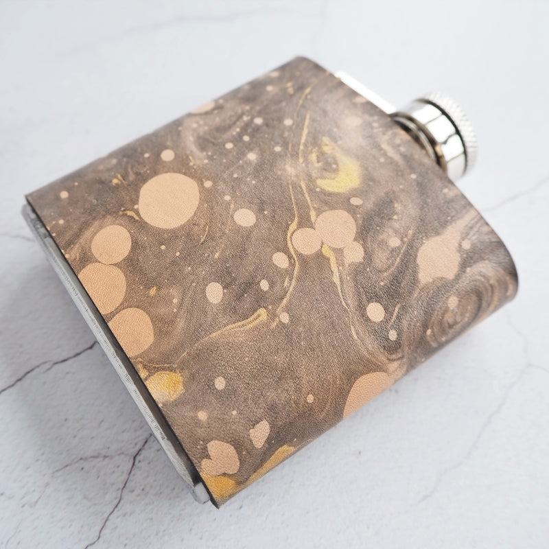 The Cosmos Hip Flask by Hord, Black and gold marbled leather hip flask