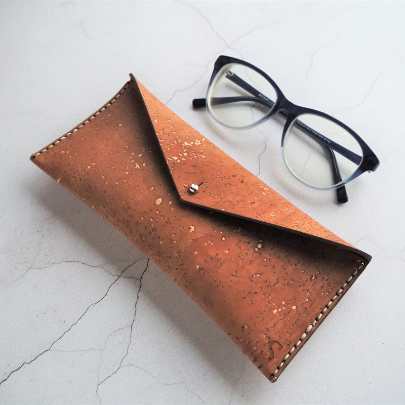 This sand brown Cork Glasses Case by HORD is the perfect companion to keep your glasses safe and secure. Hand stitched with pale waxed linen thread, it is built to last.