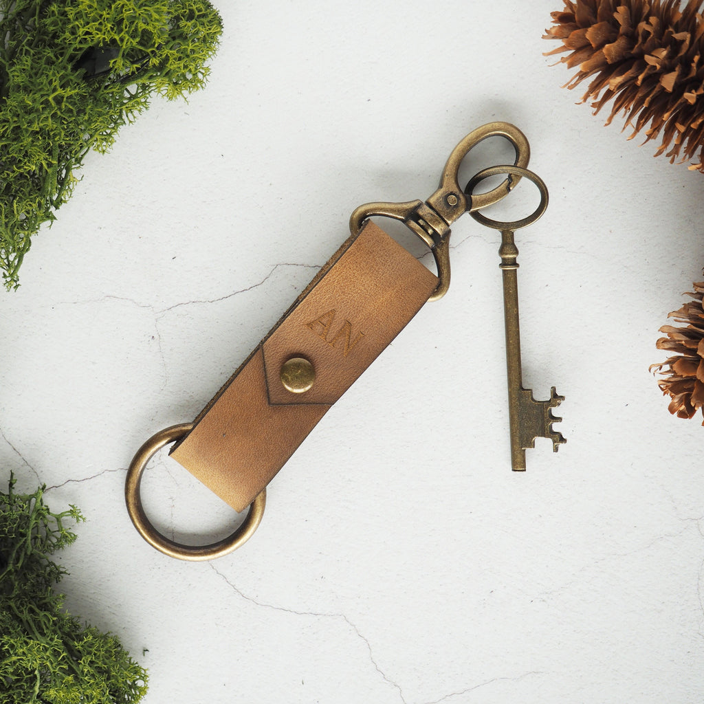The Halda Leather Key Fob in soft tan with antique brass hardware. Engraved with your choice of initials. By Hord