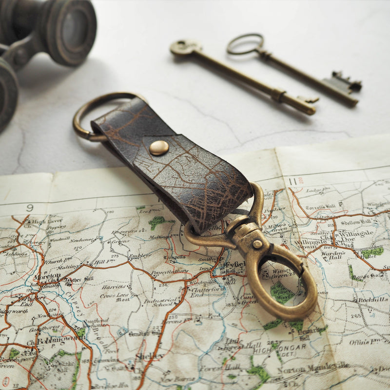 The custom road map key fob is engraved with your choice of location. Keeping your favourite place with you. By Hord.