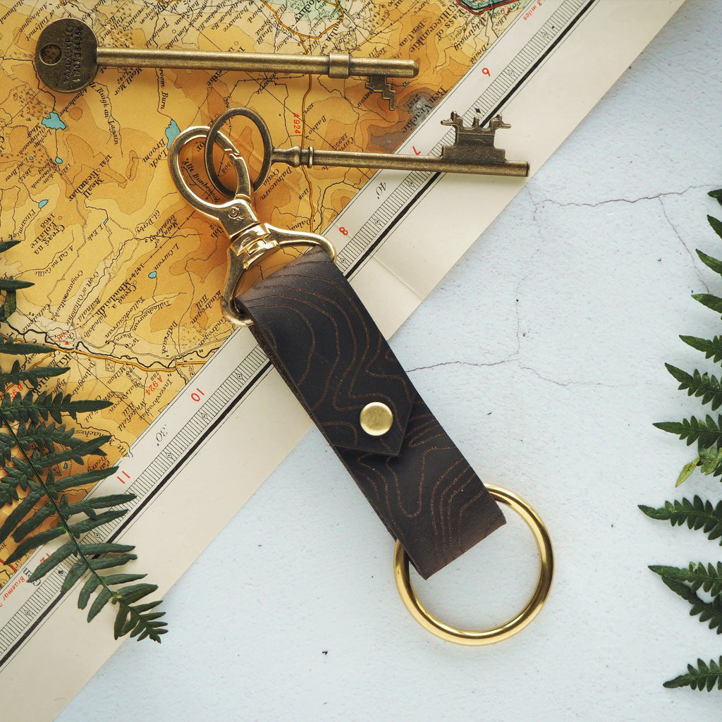 The Custom Topography Key Fob by Hord - This leather key fob makes the perfect gift for lovers of the outdoors, fully engraved with your choice of location, translated into a topographic map. A great memento of your favourite place.