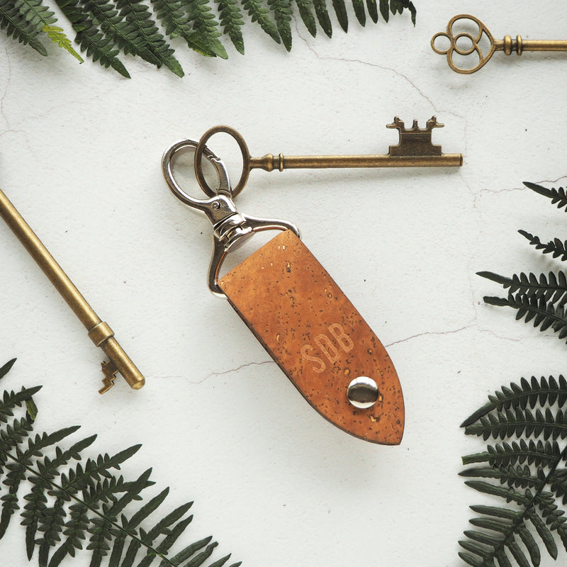 The Rof Cork Key Fob - Sand by HORD is made from sturdy sand brown coloured cork and a metal clip - This item can be engraved with your chosen initials!
