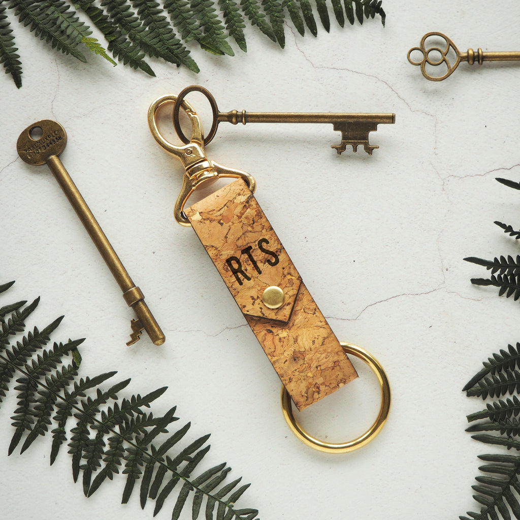 The Halda Cork Key Fob by HORD is made from sturdy flecked natural cork, a sustainable and vegan friendly alternative to leather. It can be personalised with your choice of initials.