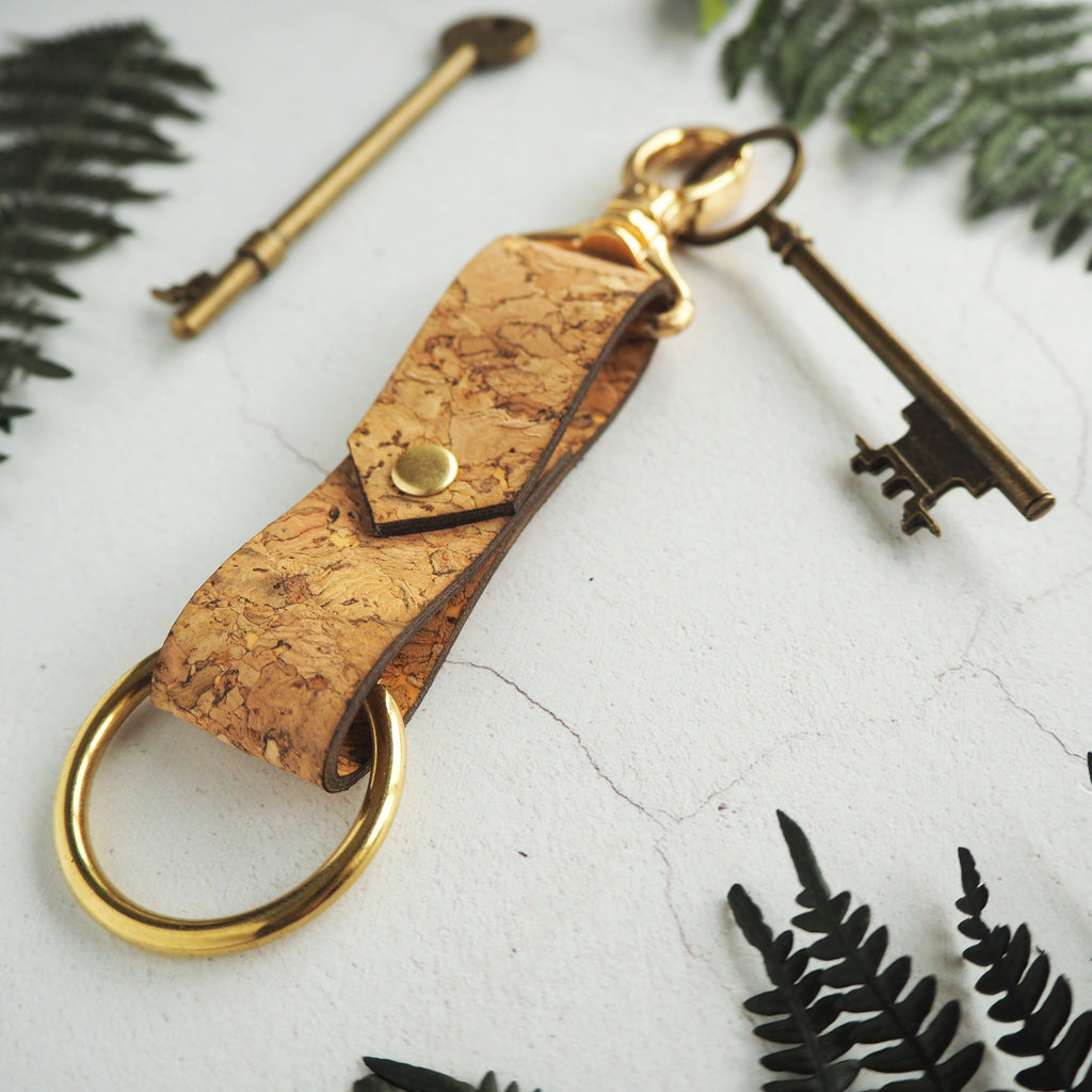 The Halda Cork Key Fob by HORD is riveted with a handy clip and bullring to attach your keys to. The hardware is available in three different colours - brass, silver and antique brass.