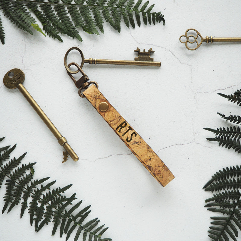 The Lykill Cork Key Fob is made from sturdy natural cork and metal hardware. This personalised key fob makes the perfect gift for those who love clean and minimalist style, but may have a tendency to lose their keys!