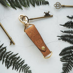 The Skor Cork Key Fob- Sand by HORD is made from sturdy natural cork and a metal clip and D-ring - This item can be engraved with your chosen initials!