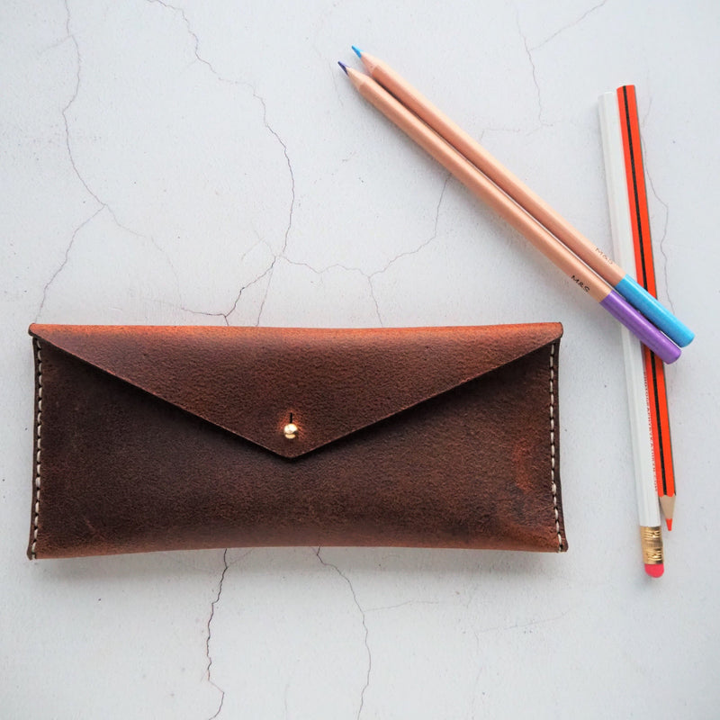The HORD Rust Leather Pencil Case is made from soft and supple pull-up leather which ages and antiques beautifully over time.