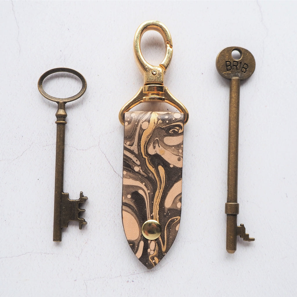 The Cosmos Key Fob by Hord, black and gold leather key ring