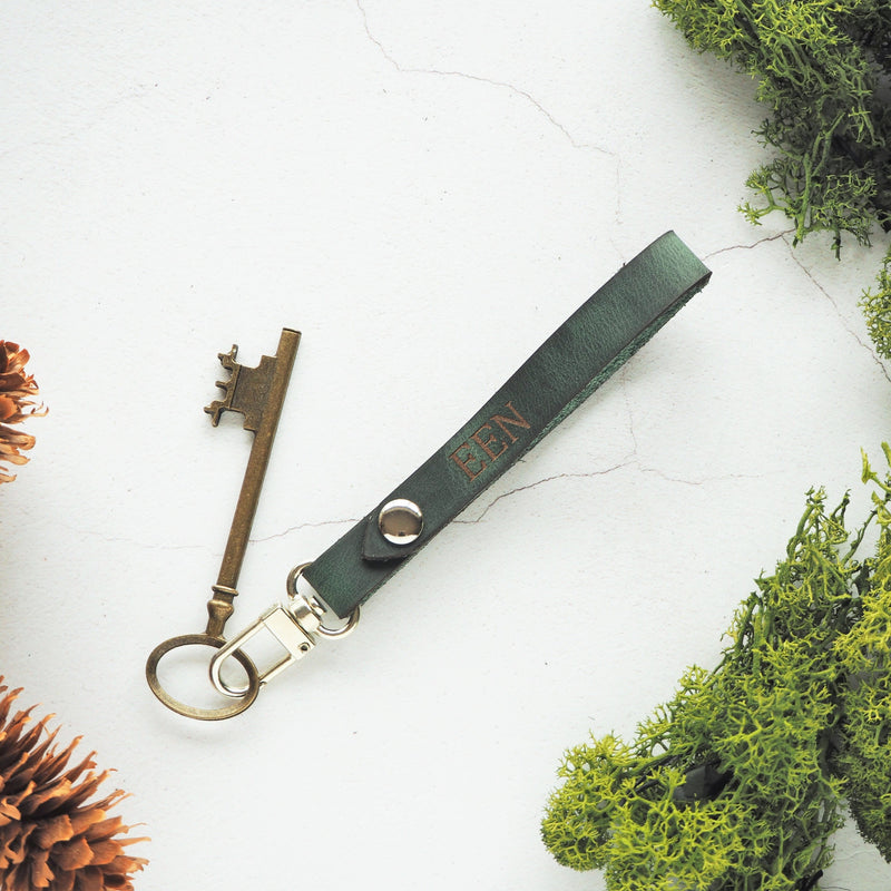 The Lykill Key Fob in Soft Green, engraved with your choice of Initials. By Hord.