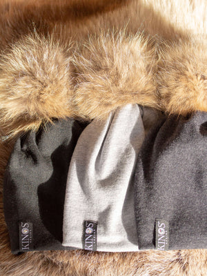 Super soft and warm light grey, black and dark grey merino wool beanies with fur pompom and one Swarovski crystal on the label made in Finland.