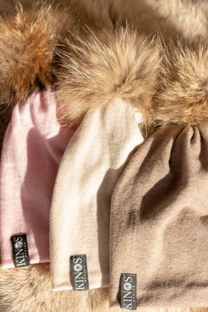 Super soft and warm frosty pink, creme and choco merino wool beanies with fur pompom and one Swarovski crystal on the label made in Finland.