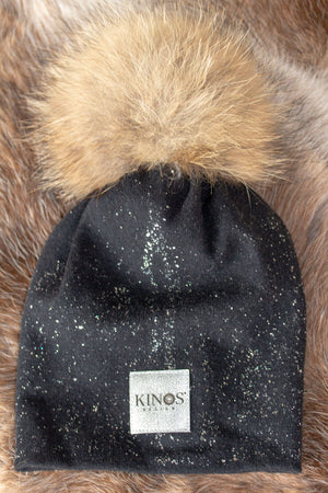 Super soft and warm charcoal black merino wool Snow Glow Kinos beanie with wild fur pompom made in Finland.