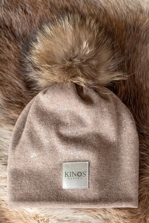 Super soft and warm choco brown merino wool Snow Glow Kinos beanie with wild fur pompom made in Finland.