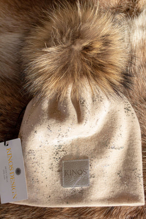 Super soft and warm creme beige merino wool Snow Glow Kinos beanie with wild fur pompom made in Finland.