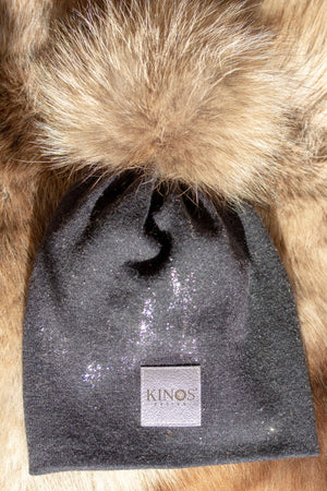 Super soft and warm stone dark grey merino wool Snow Glow Kinos beanie with wild fur pompom made in Finland.