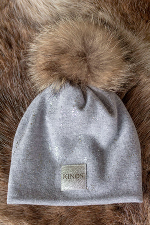 Super soft and warm lichen light grey merino wool Snow Glow Kinos beanie with wild fur pompom made in Finland.