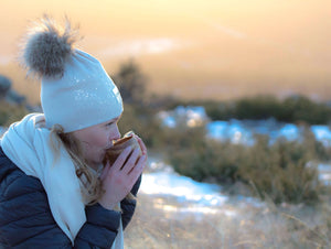 Super soft and warm creme merino wool Snow Glow Kinos beanie with wild fur pompom made in Finland.