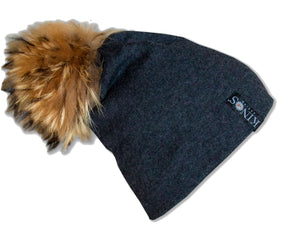 Stone grey merino wool classic Kinos beanie with wild fur pompom and one Swarovski crystal made in Finland.