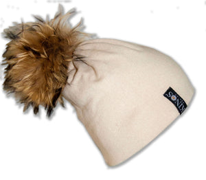 Creme beige merino wool classic Kinos beanie with wild fur pompom and one Swarovski crystal made in Finland.