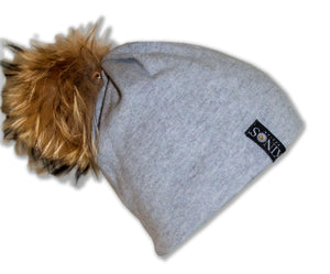 Lichen light grey merino wool classic Kinos beanie with wild fur pompom and one Swarovski crystal made in Finland.
