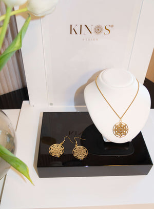 Gold stainless steel Mandala Sun necklace and earrings by Kinos Design