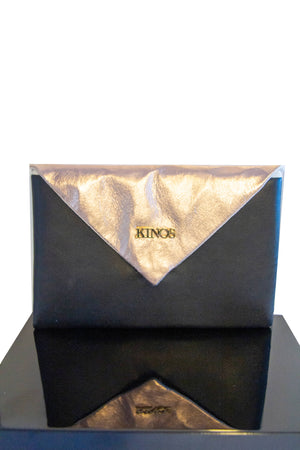 Black and rose gold reindeer leather Arctic Clutch by Kinos Design made in Rovaniemi Finland