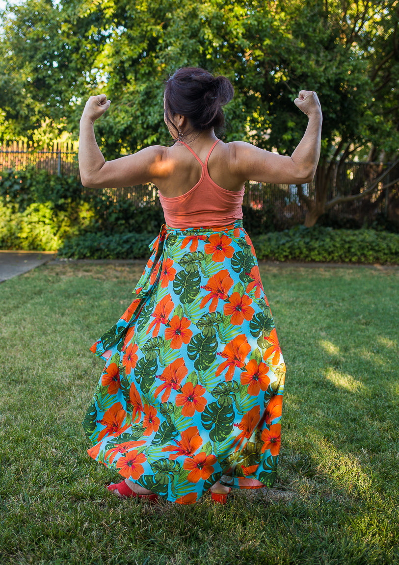 strong woman in floral wrap skirt maria canta